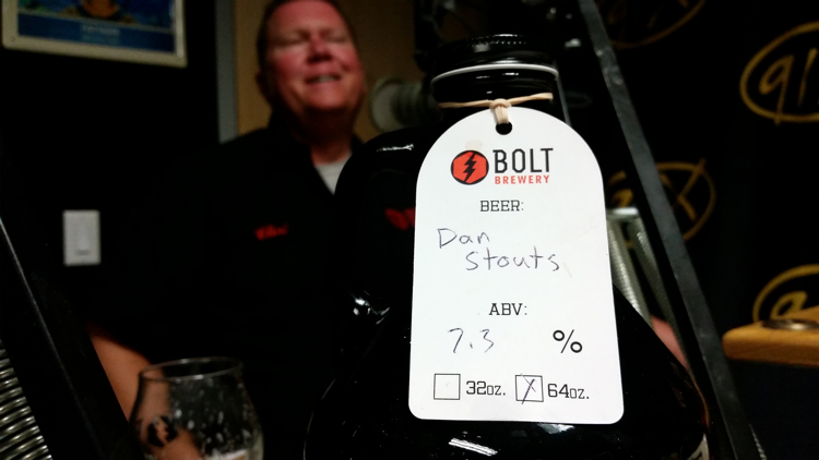Bolt Brewery master brewer Clint Stromberg and a growler of Dan Stouts.